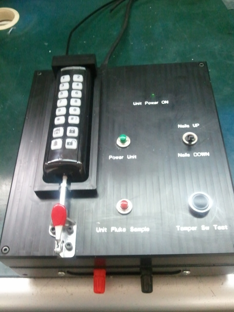 Semi automatic test fixture for keyboard .